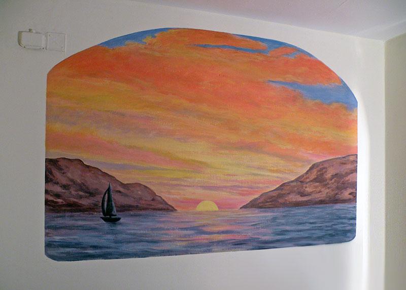 ציור קיר של שקיעה בים