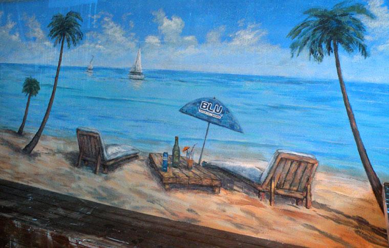 ציורי קיר חוף הים עם אוניות ושמשיה