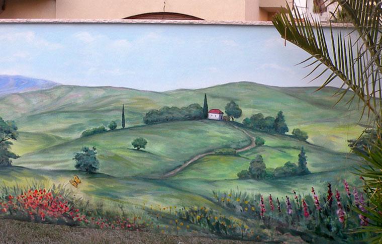 ציור נוף עם בית ופרחים על קיר